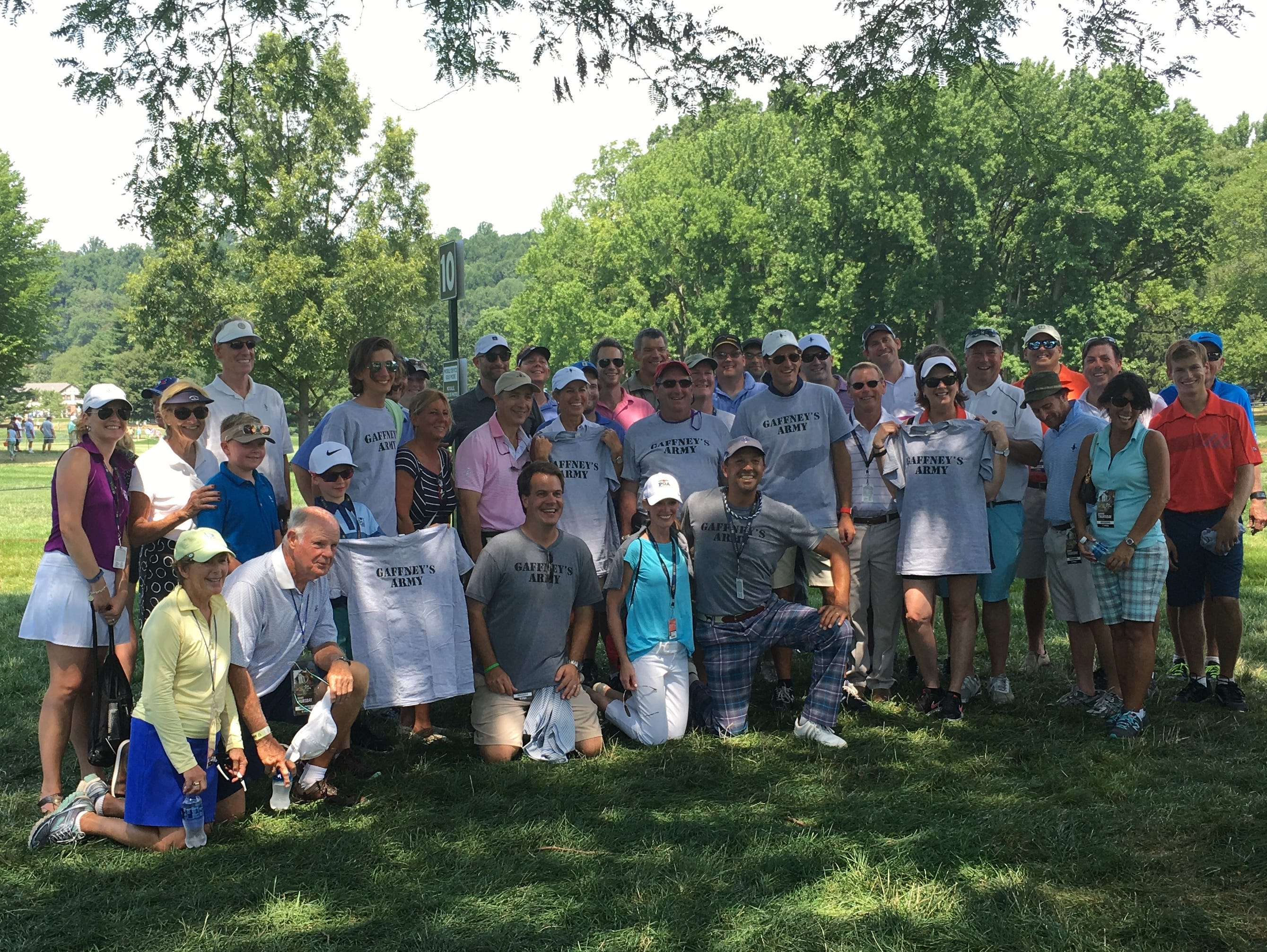 Thomas Pablo (center with plaid pants) originated Gaffney's Army last year at Whistling Straits and was back Thursday at Baltusrol with t-shirts for the nearly 40 friends and family members that came to watch the Quaker Ridge head professional compete in the 98th PGA Championship.