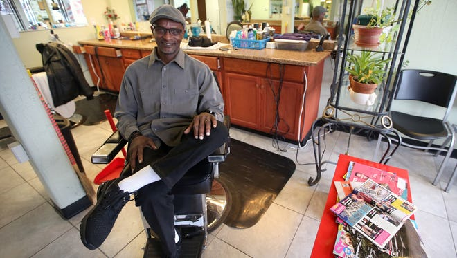 Darryl Riley in his barber's chair at Joy's Barbershop in Bremerton on Monday, Jan. 29, 2018.