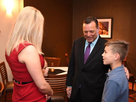 Ericka Downey and son Bryce meet Billy Gillispie for