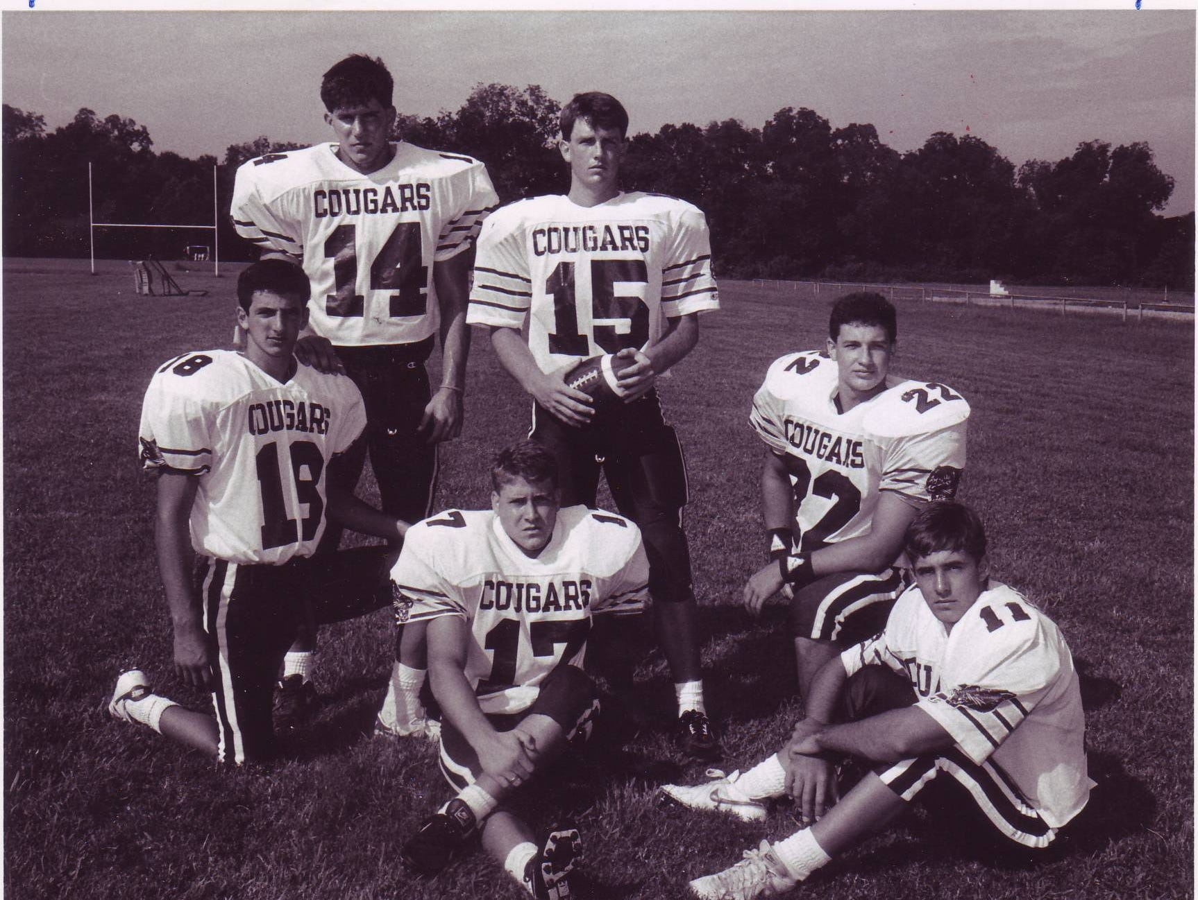 St. Thomas More quarterback Jamie Howard (15) and his stable of receivers helped to bring the Cougars' program to its first state semifinal trip in 1991.