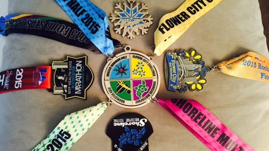 The four medals and the four medal pieces (combined