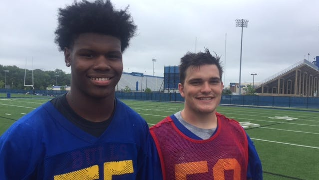 Charlie Hope (left) from William Penn and A.J. McGonigle from St. Mark's team up for the Blue team, just as their fathers did while becoming close friends.