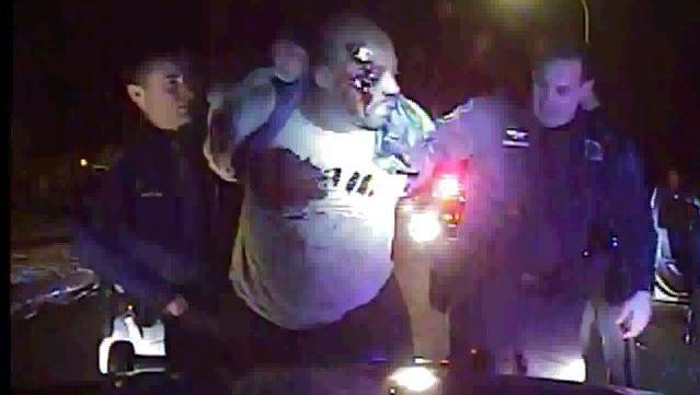 """A frame grab of dashcam video from an Inkster patrol car shows a bloodied Floyd Dent during the traffic stop. """"The problem is that one officer affects the entire profession,"""" said David Harvey, the former director of the Michigan agency that licenses officers."""