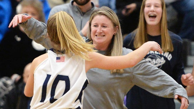 Rockland's head coach Diana Newcomb congratulates Hannah Murphy during their game versus Archbishop Williams on Friday, March 6, 2020.