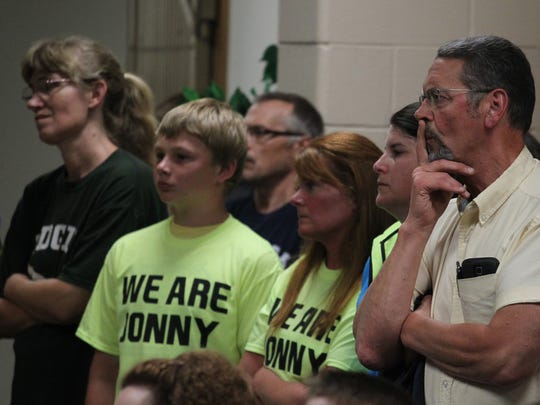 A crowd listens to a speaker at the Edgar School Board meeting as the bullying-related suicide of Jonathan Wesener and its aftermath are discussed.