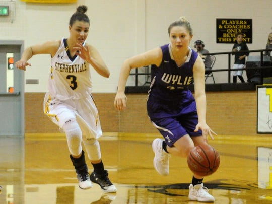 Wylie guard Skylar Williams (32) drives pas Stephenville's Payton Wall (3) during the Lady Bulldogs' 63-45 win in the Region I-4A quarterfinals in Cisco on Tuesday, Feb. 20, 2018.