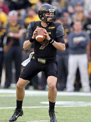 Nov 21, 2015; Hattiesburg, MS, USA; Southern Miss Golden Eagles quarterback Nick Mullens (9) looks to throw a pass against the Old Dominion Monarchs at M.M. Roberts Stadium.