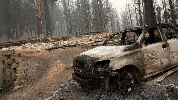 A burned out truck sits in front of a structure that was destroyed by the King fire on September 19, 2014 near Pollock Pines, California.