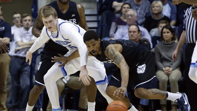 Xavier Musketeers guard J.P. Macura (55) has the ball stolen during the second half by the Butler Bulldogs guard Kethan Savage (11) at the Cintas Center. Butler won 88-79.