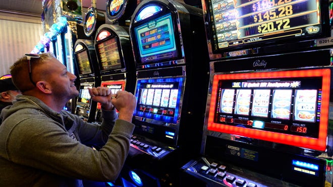 Spencer resident Jon Brown wins while playing a video gaming machine at Tioga Downs on Tuesday.