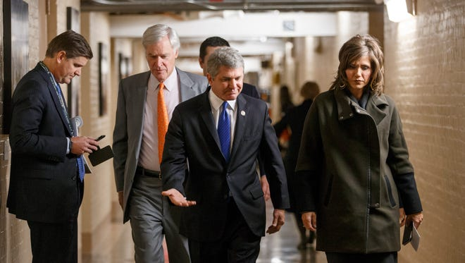 Homeland Security Committee Chariman Michael McCaul, R-Texas,  walks through a basement corridor at the U.S. Capitol.