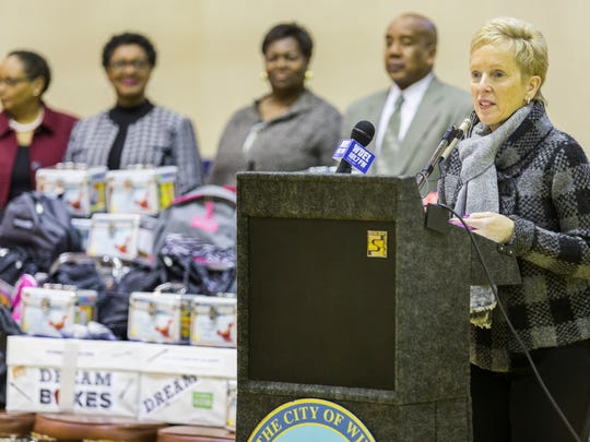 "Michele Fidance with the Jefferson Awards speaks at the announcement of over 100 ""dream boxes"" of school supplies for children at the William ""Hicks"" Anderson Community Center in West Center City in Wilmington on Tuesday afternoon."