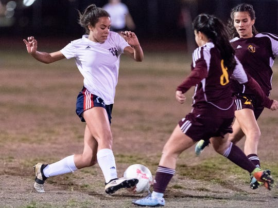 Tulare Western's Ana Porchia advances on Tulare Union's Elvira Garcia in a Central Section Division II semifinal girls soccer game on Tuesday, February 20, 2018.