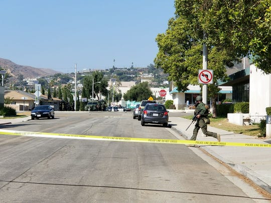 The police presence was visible Friday afternoon as authorities hunted for a double-homicide suspect in Ventura.