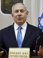 Israeli Prime Minister Benjamin Netanyahu chairs the weekly cabinet meeting at his Jerusalem office, Sunday, March 10, 2019. The Israeli prime minister said he's looking into legalizing cannabis.