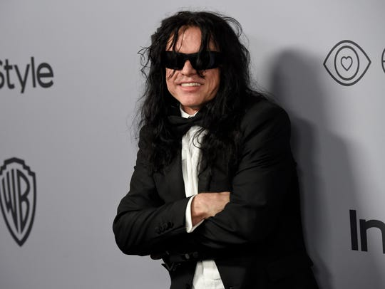 Tommy Wiseau arrives at the InStyle and Warner Bros.