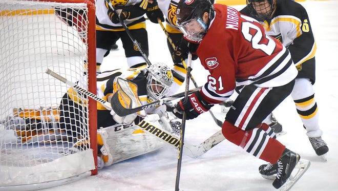 St. Cloud State's Jimmy Murray gets control of the puck in front of Colorado College goaltender Jacob Nehama during Friday's game at the Herb Brooks National Hockey Center in St. Cloud.