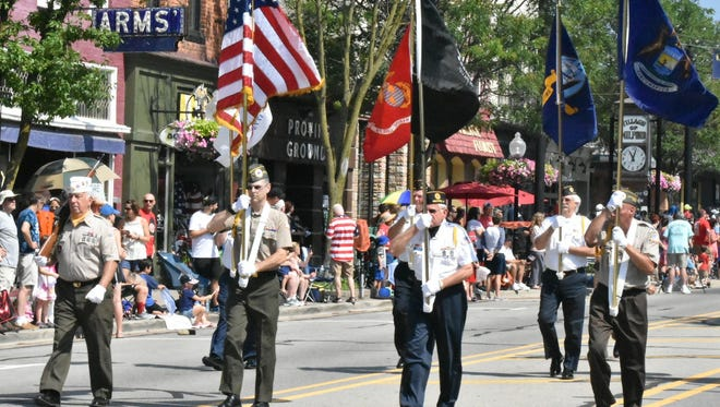 A military color guard stepped off to start Milford's Fourth of July parade.
