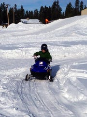 Kid-sized snowmobiles and a mini-course gives kids a chance to try out the sport.