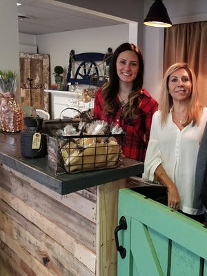 Shelby Hamilton, 22, and Gina Mashburn, 50, stand in their newly opened shop, Fifty Shades of Shabby, in Algonac.
