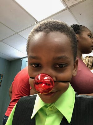 A teacher at Evangeline Elementary gave Hayden Albert, 7, a red nose to wear during a recognition ceremony Monday after giving him 'awards' for class clown and most talkative.