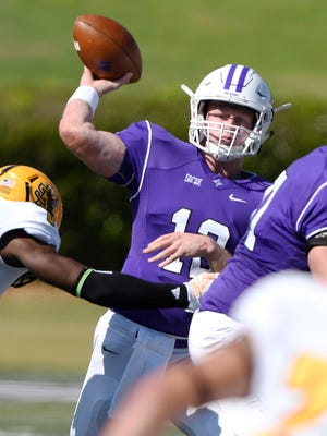 Furman quarterback Reese Hannon (12) fires a pass under pressure from Kennesaw State Saturday. Hannon threw a career-high five touchdown passes in the Paladins' 52-42 loss.