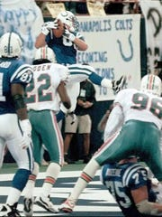 Ken Dilger hauls in the Colts' only first half TD with