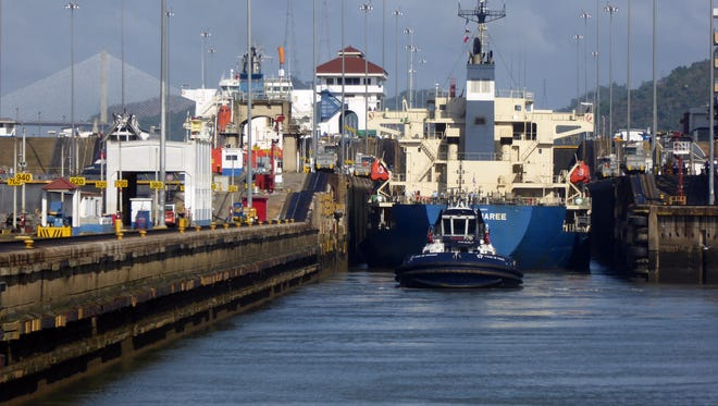 A cargo ship eases through a lock in the Panama Canal.