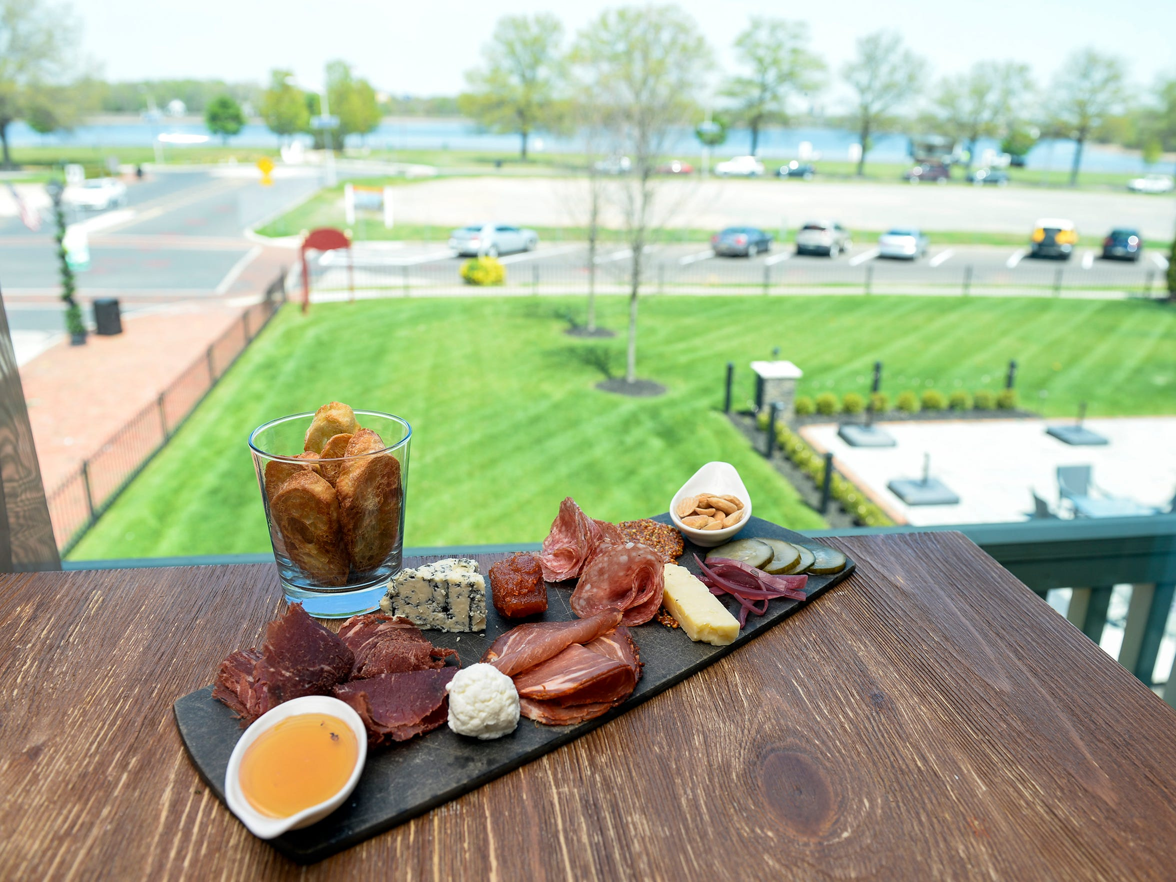 A charcuterie board sits atop a table overlooking the