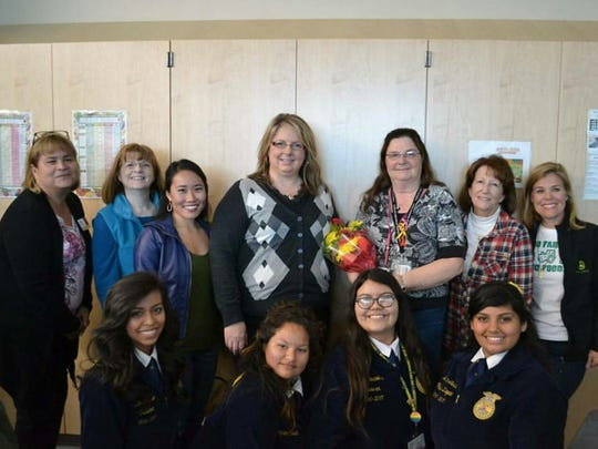 Melissa McBride was surprised earlier this year by the women of CWA when her award was officially announced. Some of her students are also celebrating with her.