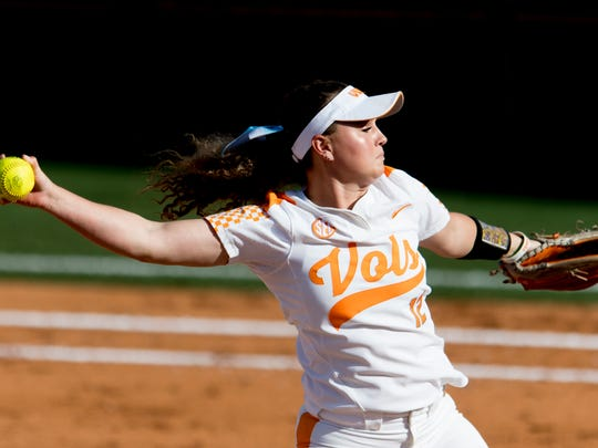 Tennessee pitcher/utility Caylan Arnold (12) pitches during a game between Tennessee and Georgia at Sherri Parker Lee Stadium in Knoxville, Tennessee on Saturday, March 31, 2018.