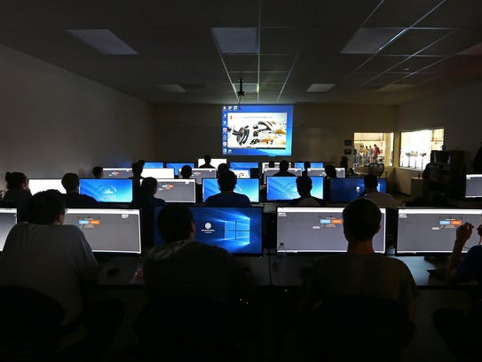 Students inside the Computer Aided Drafting lab at