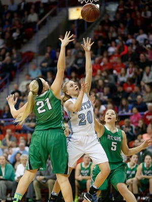 Regis' Hannah Anderson (21) and Kayla Neff (5) defend Mineral Point's Clara Chambers during the first half of Thursday's WIAA Division 4 girls' state basketball semifinal at the Resch Center in Ashwaubenon.