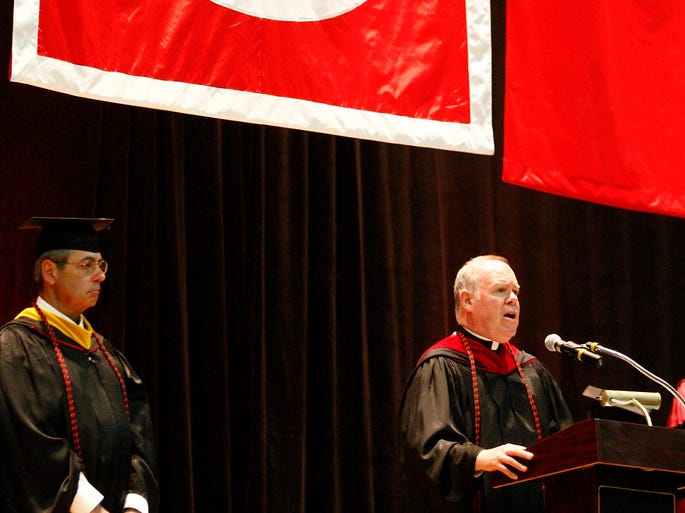 Father Michael Karrigan gives the invocation during Dominican College's Commencement Ceremony at the Westchester County Center in White Plains on Sunday, May 18, 2014.