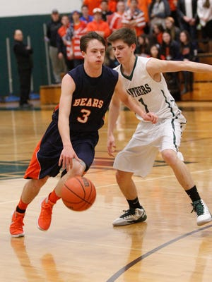 Briarcliff's Jack Ryan (3) dribbles past Pleasantville's Mike Manley (1) during a boys basketball game at Pleasantville High School on Tuesday, Jan. 19, 2016.