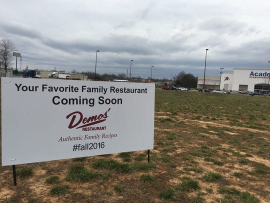 Demos' has its building permit for a vacant lot between