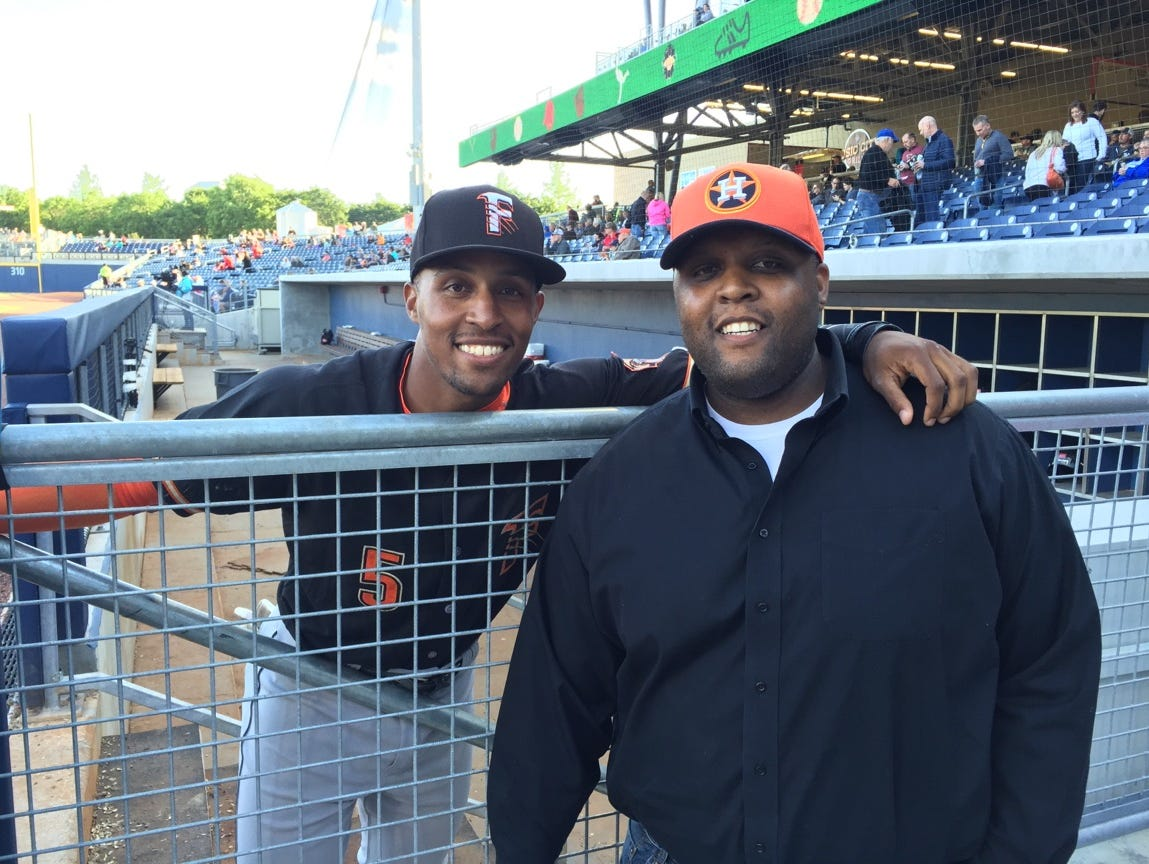 Former Centennial High and Vanderbilt standout Tony Kemp, left, poses with his older brother, Corey, prior to Saturday's battle between Kemp's Fresno Grizzlies and the Nashville Sounds.