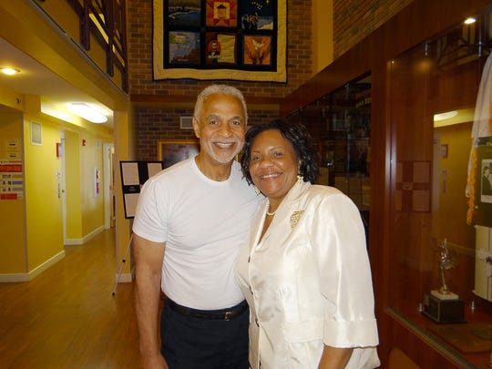 """Actor, philanthropist and Evansville native Ron Glass (left) paid a surprise visit to the Evansville African American Museum on Monday. The museum, led by Executive Director Lu Porter (right), has on display a variety of artifacts related to Glass' four-decade career in film and television. Glass, whose extensive list of credits most notably includes his portrayal of Det. Ron Harris on the popular sitcom """"Barney Miller"""" from 1975 to 1982, is a graduate of the University of Evansville and sits on UE's Board of Trustees. The permanent showcase at the museum, located at 579 S. Garvin St., includes several of Glass' photographs, a Key to the City received in 1982, his """"Detective Harris"""" badge, and several awards and medals."""