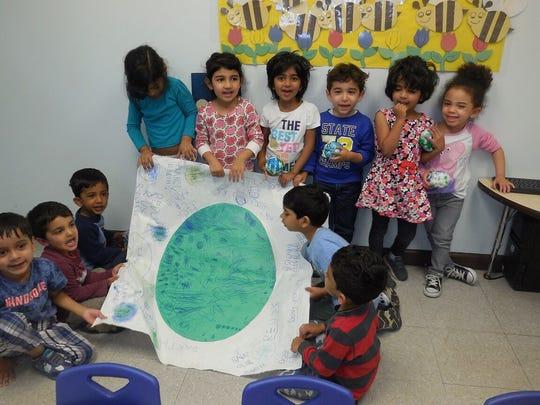 "Preschoolers celebrate 7th annual ""Root for Earth"" week."