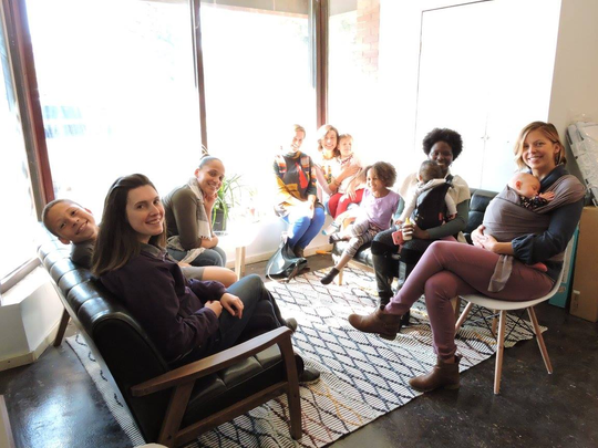 Parents and children relax at the Detroit Parent Collective, a new coworking space and preschool in northwest Detroit.
