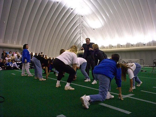 Jim Brandstatter, an East Lansing native, is seen here in this 1998 photo helping participants during a Detroit Lions football workshop.