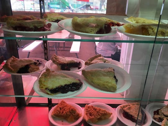 Homemade pie slices sit in a case at the First English