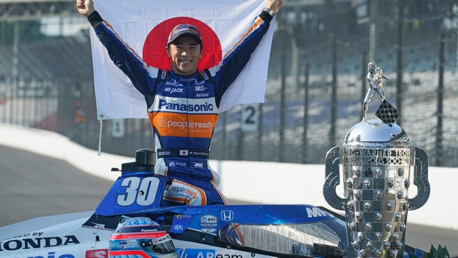 Takuma Sato, of Japan, winner of the 2020 Indianapolis 500 auto race, poses during the traditional winners photo session at the Indianapolis Motor Speedway, Monday, Aug. 24, 2020, in Indianapolis.