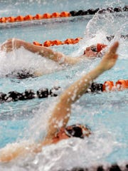 Susquehannock's Justin Reed, top, swims the backstroke