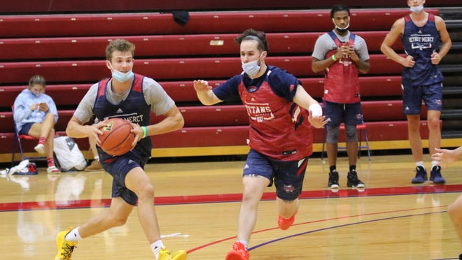 Erie Mason's Joey Liedel handles the ball during a recent practice with the University of Detroit Mercy.