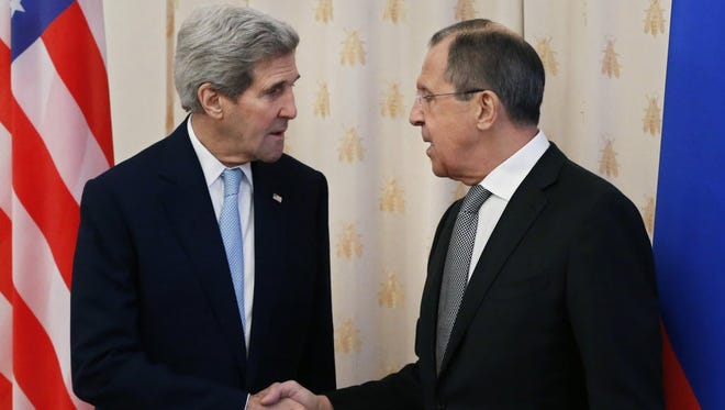 Secretary of State John Kerry, left, meets with Russian Foreign Minister Sergei Lavrov, in Moscow, on Dec. 15.