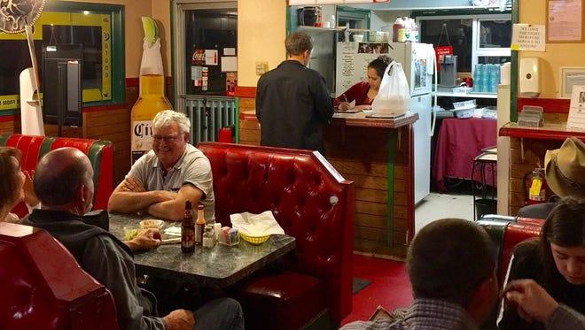 Diners at the homey Macias El Michoacano Mexican restaurant in Cottonwood.