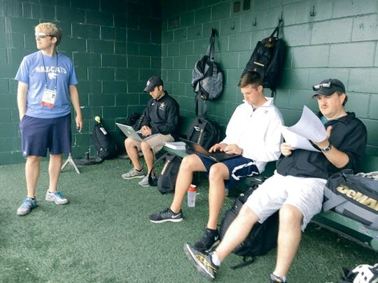 Vanderbilt support staff with me in dugout at practice