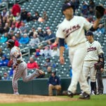 Baltimore Orioles outfielder Adam Jones (10) hits a home run in the ninth inning Wednesday against Minnesota Twins pitcher Brandon Kintzler (27) at Target Field. The Baltimore Orioles beat the Minnesota Twins 9-2.