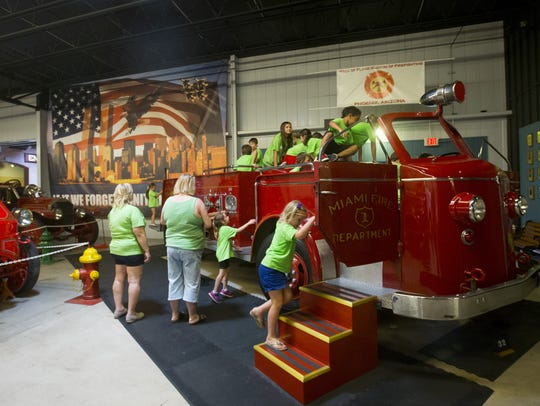Kids can climb into a firetruck at the Hall of Flame